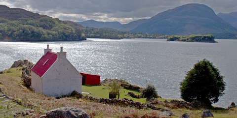 Image of a cottage by the loch, public domain